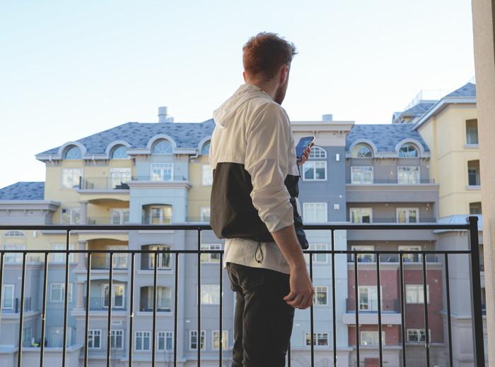 A man on a balcony