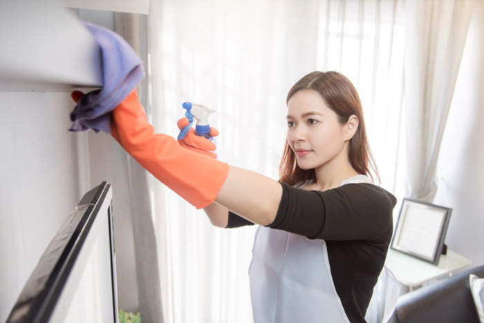 A room attendant cleaning a hotel room