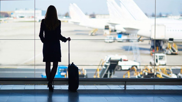 A woman waiting to board an airplane