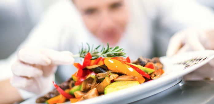 A chef arranging a plate - Source National Restaurant Association