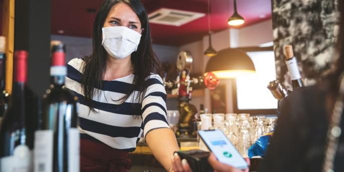 A bartender wearing a mask - Source National Restaurant Association
