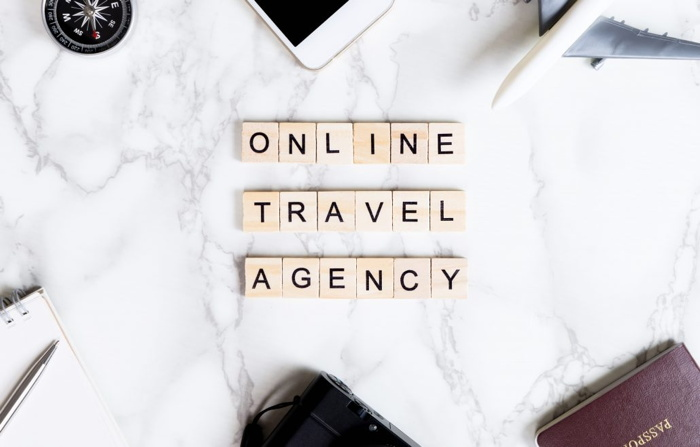 The words 'Online Travel Agency' with Scrabble letters