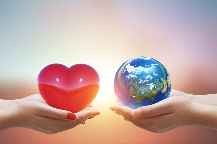 A heart and globe in two hands