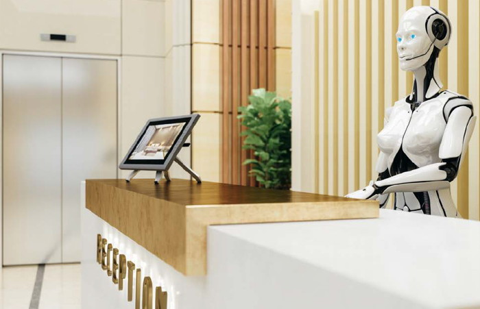 A robot behind a hotel check-in counter - Source Horwath HTL