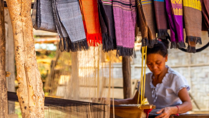 A woman at a market stall - Source UNWTO