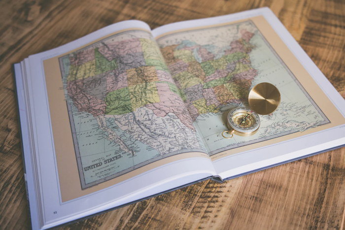 A map of the United States and a compass - Unsplash