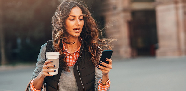 A woman looking at a mobile phone