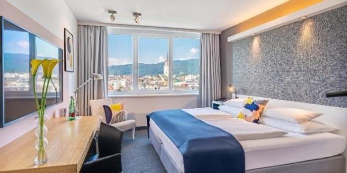Guestroom at the voco Villach Hotel