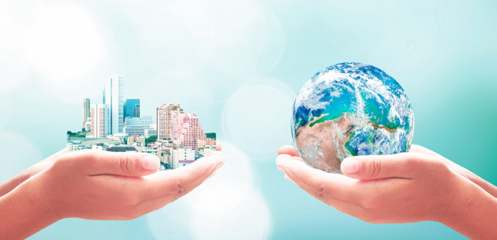 Graphic - Hands holding a city and a globe - Source Horwath HTL