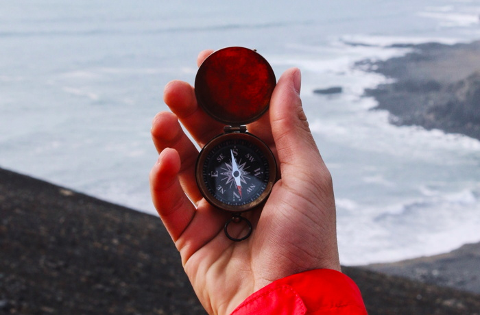 A person holding a compass
