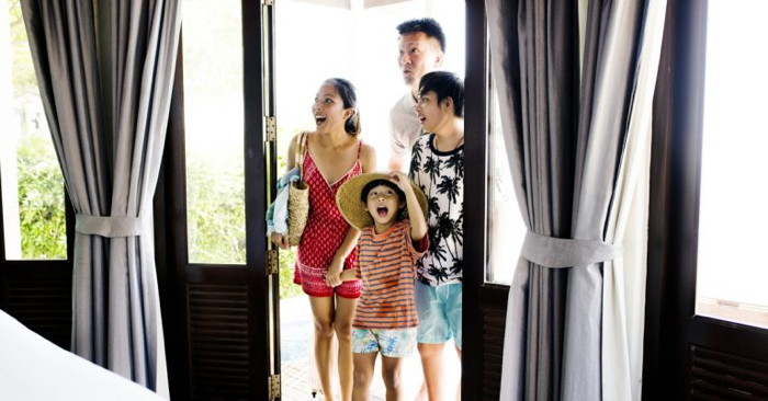 A family looking at a hotel room