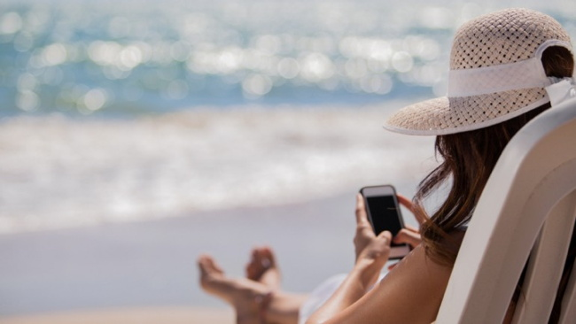 A woman sitting in a beach chair - Source Vizergy