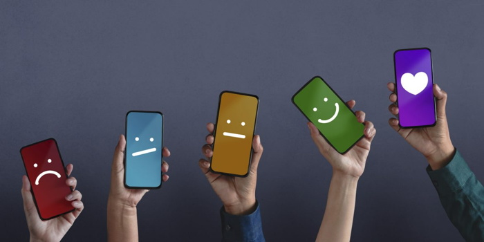Cellphones with emojis - Source - STAAH