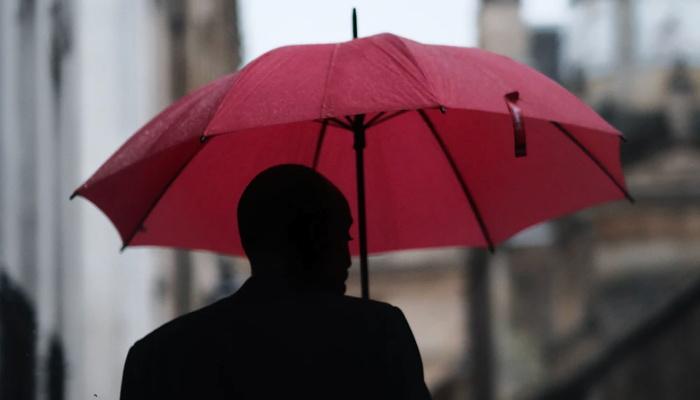 a man with a red umbrella - Unsplash