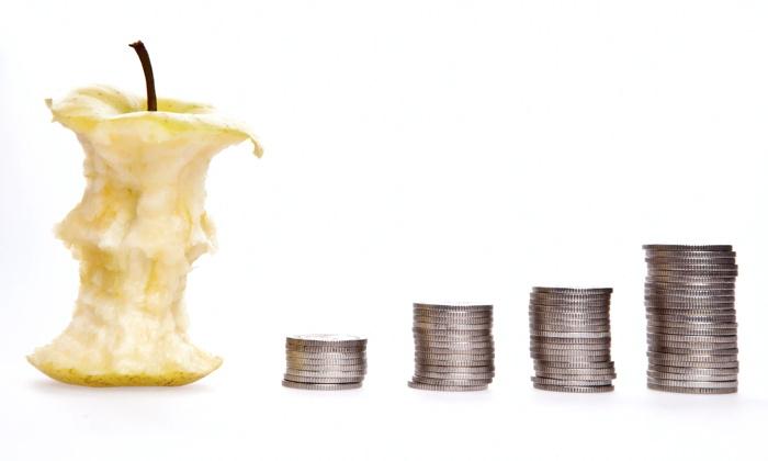 Leftover bit apple with coins - Damir Spanic at Unsplash