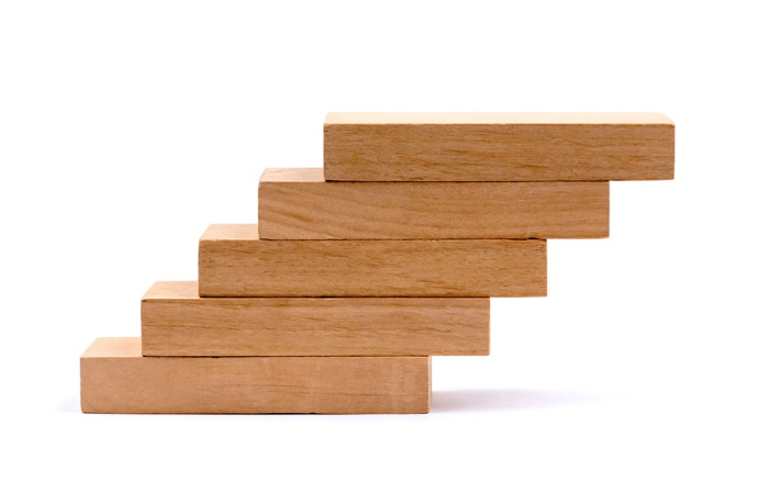 Wood block stacking as step stair, Business concept for growth success - Volodymyr Hryshchenko - Unsplash