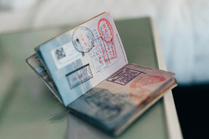 An open passport with stamps - Unsplash