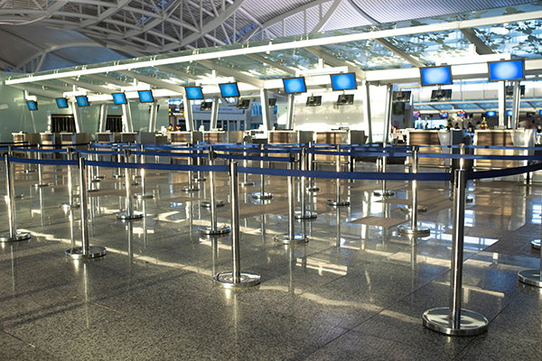 Empty airline check-in counter - Source WTTC
