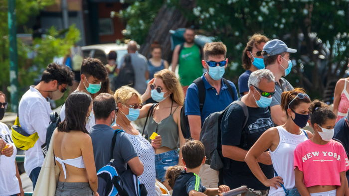 A group of people wearing face masks - Source UNWTO