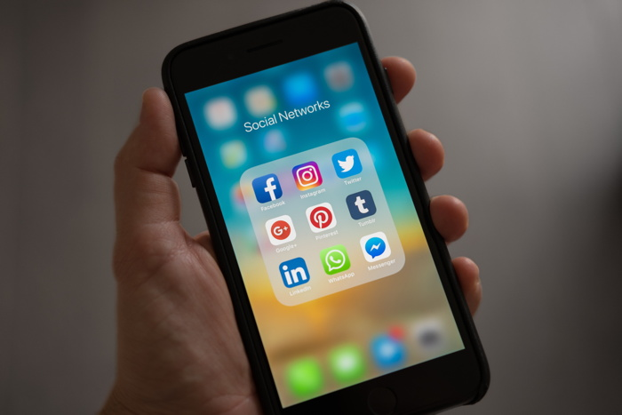Social media apps on a cell phone - Source - Hotelogix