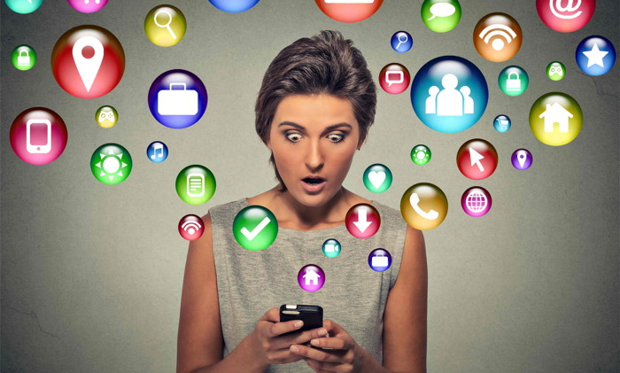 A person surrounded by social media icons - Source Kennedy Training Network