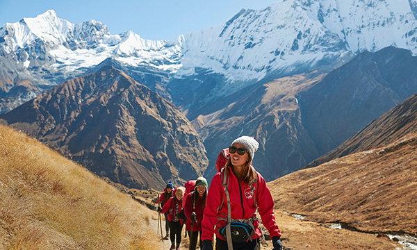Tourists on a mountain climb - Source WTTC
