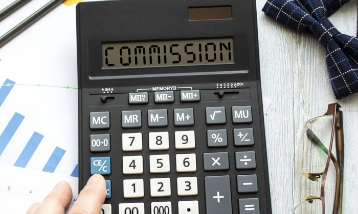 A calculator with the word 'Commission'