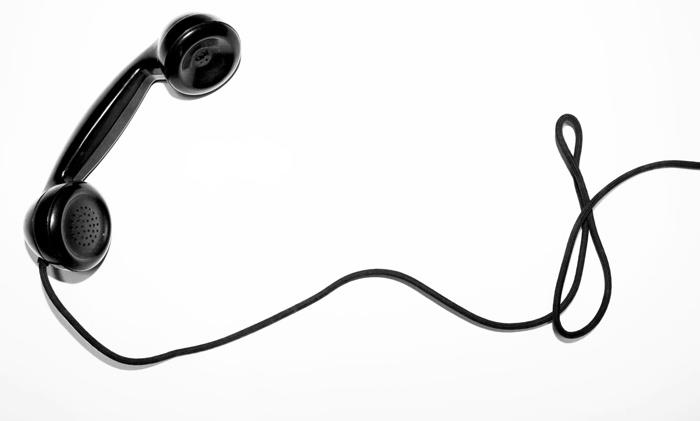 Old fashioned telephone receiver - Unsplash Quino Al