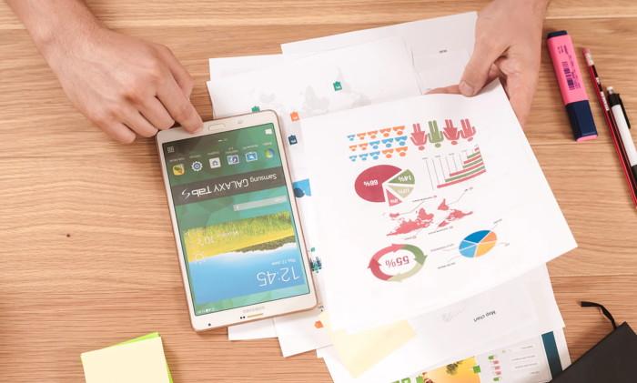 Charts on a desk - Unsplash @firmbee