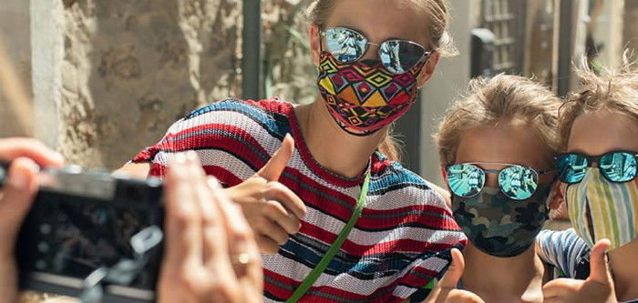 A group of people wearing face masks - Source ABTA