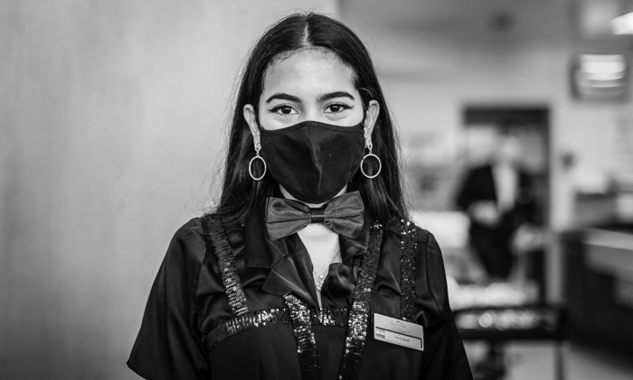 A hotel employee wearing a face mask - Source Swiss Education Group