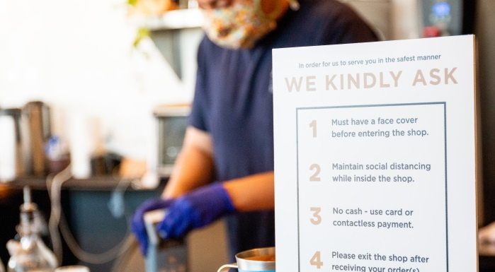 A sign in a restaurant with Covid policies - Source National Restaurant Association
