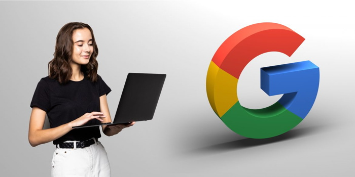 A person holding a laptip and the Google 'G' logo - Source STAAH