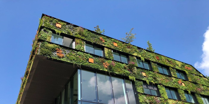 Exterior of a building with plants - Source HSMAI