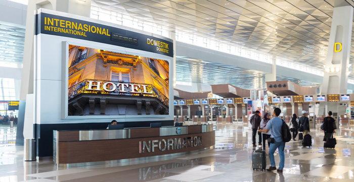 A hotel advertisement at an airport - Source - Hotelogix